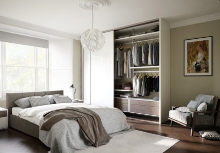 A hero three quarter angle 3d visualisation of a modern bedroom naturally coloured and naturally lit with an open free standard wardrobe with minimal furniture