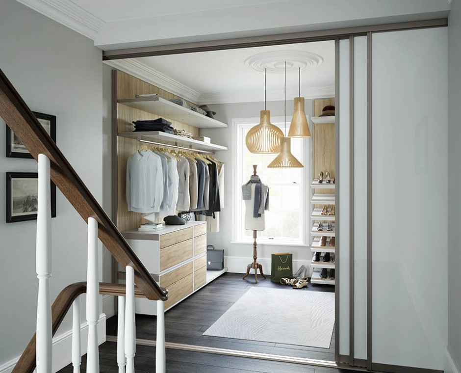 Hero three quarter stairs 3D Interior Visualisation of a daytime natural lit walk in wardrobe with open sliding doors