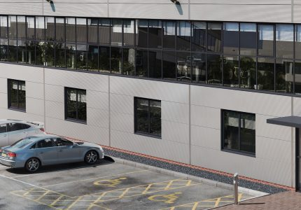 cgi render of front of office and car park